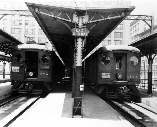 "6th and Main Station on Flickr. circa 1942 Cars 379 and 4516 at the 6th & Main Streets elevated station during World War II. Number 379 is from the Southern Pacific electric commuter system called ""Interurban Electric Railway"" which served many cities in the San Francisco eastbay area. Car 4516 was ex-Northwestern Pacific Railway, another electric suburban comuter operation in Marin County, north of San Francisco. Both cars were used during World War II to serve the Calship shipyard on Terminal Island, and were owned by the United States Maritime Commission. In the later (postwar) 1940s, these cars were rebuilt into (NWP cars) 300 and (IER cars) 400 series ""Blimps,"" many of which closed out the last Pacific Electric Railway ""Red Car"" line to Long Beach in 1961."