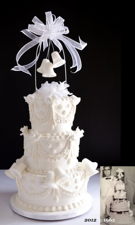 50th WEDDING ANNIVERSARY CAKE: This retro Wedding Cake was recreated to mark the occasion of a 50th anniversary. The bells were cast in granulated sugar and the narcissus flowers were made of royal icing. White buttercream enrobes the three tiers; the top two were chocolate on chocolate and the bottom was vanilla filled with fresh strawberry buttercream.
