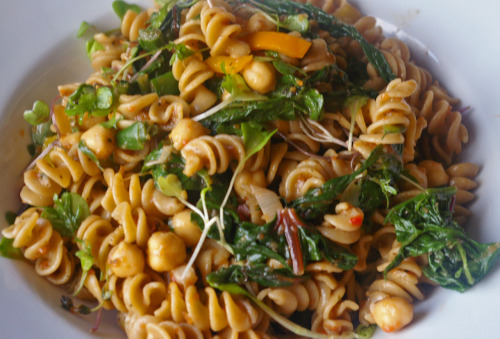 meaghanherself:  Warm pasta salad with whole wheat rotini, wilted swiss chard and spinach, chickpeas,  green onions, mini bell peppers, microgreens, fresh thyme, and a homemade roasted red pepper vinaigrette.
