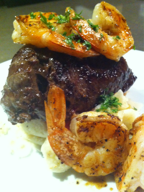 Grilled Filet Mignon topped w/ marinated grill shrimp on a bed of garlic mash potato