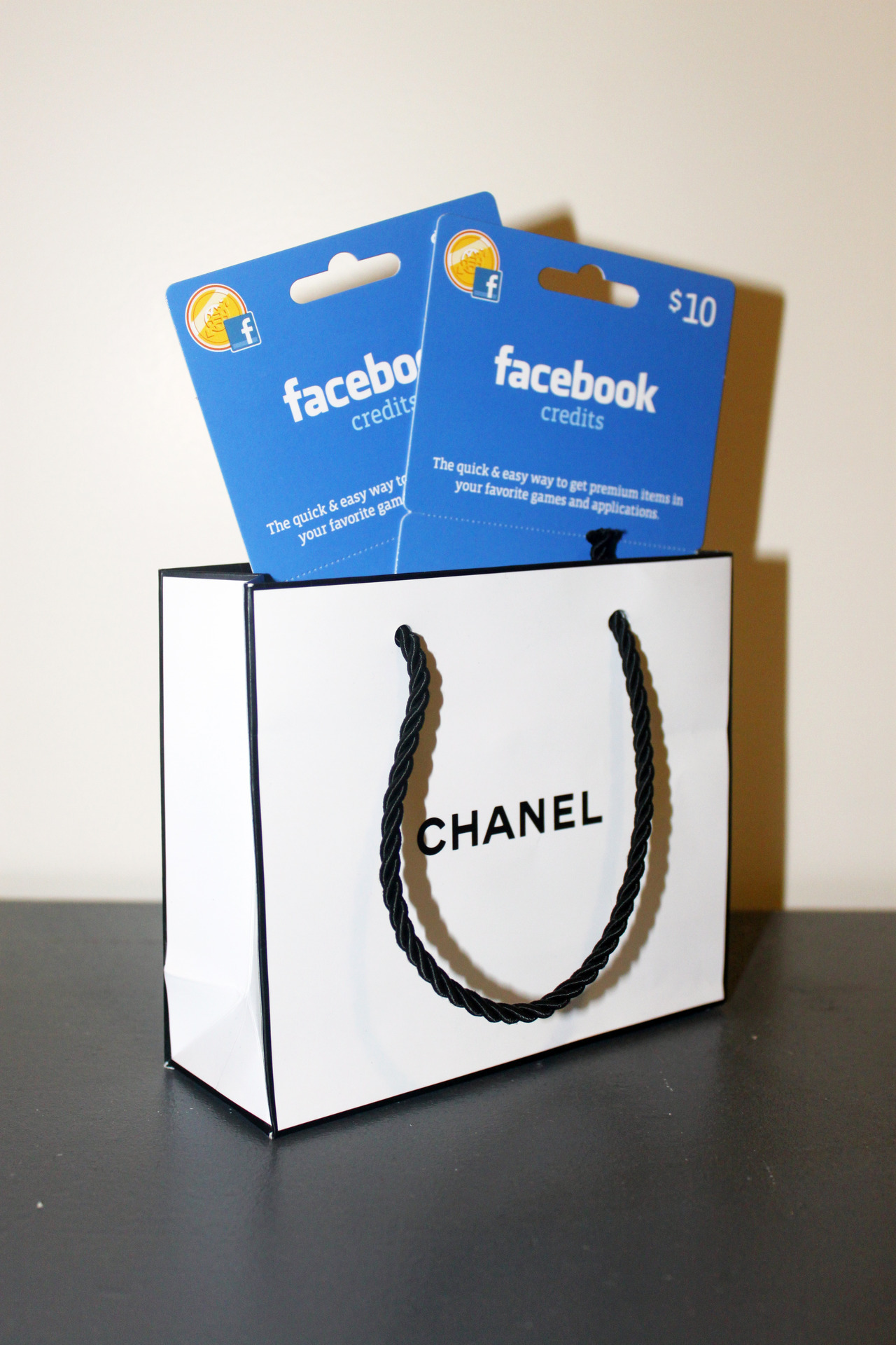MINI CHANEL BAG WITH TWO $10 FACEBOOK CREDITS GIFT CARDS (PAID FOR AND ACTIVATED), 2012 Sculpture ☐