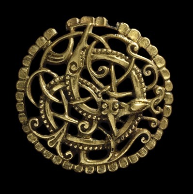 "nihtern:  Gilded bronze Anglo-Scandinavian brooch, 11th century AD. Found in Pitney, Somerset, England.  ""An entwined animal and snake in combat…. The design, with its plant-like tendrils and ribbon animals, is an English version of the final phase of Viking art, the Urnes Style. However, the delicate beading which picks out the main animal, and the scalloped border of the brooch are both Anglo-Saxon features…."" Source: www.britishmuseum.org  oooh I need this"