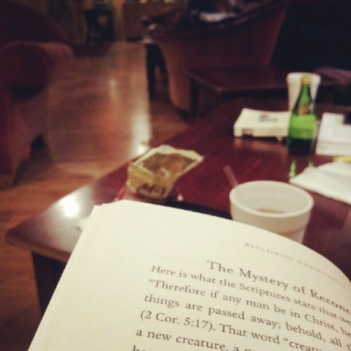 Peach iced tea. Couch. Tozer. Mozart. (Taken with Instagram at McClain's Coffeehouse)