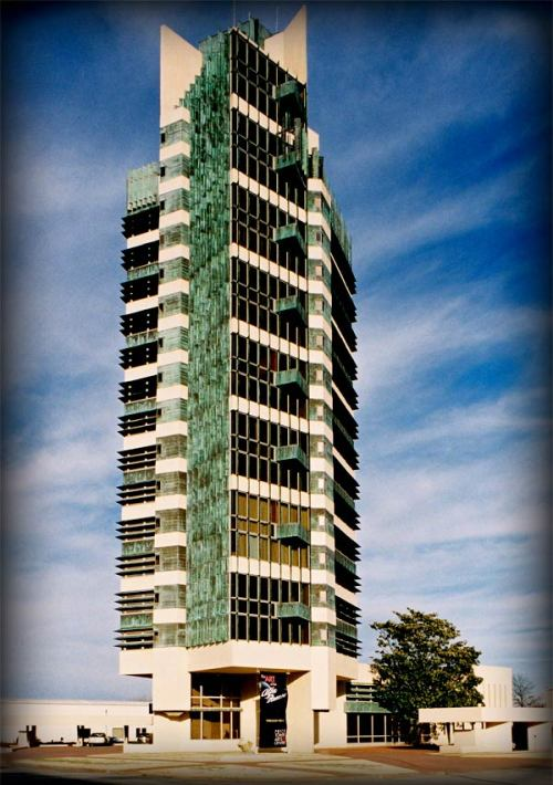 "dtxmcclain:  Price Tower in Bartlesville, Oklahoma, 1956. At 19-stories high, it's Frank Lloyd Wright's only ""skyscraper""."