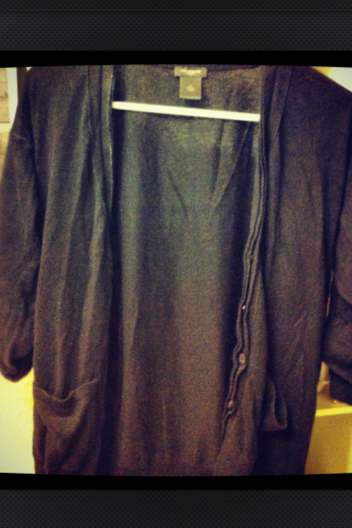 Day 12: A photo of your favorite item of clothing.   Black sweater from Ann Taylor. This was a hard challenge because originally I wanted to pick a cool t-shirt, but I have at least 50 tees… All of which I like A LOT. Then all my other clothes I am in hate with right now.  So I chose this sweater. I bought it last year on Mike's birthday. I wore it all through my pregnancy with Kendall. I belt it when I want to look professional or semi casual (which by the way it usually isn't this wrinkled). I throw it on with over a t-shirt to look a little less casual when I am work. Throw a crocheted beret with it and my reading glasses and I'm suddenly hipster. Stick a flower in my hair and I'm suddenly a fashionista. From fall to summer I have worn this at least once a week and it's going to suck when it is too fades to continue wearing. I heart heart it that much.