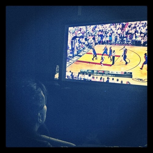 candid shot, thanks to the roomie. this is how i watch basketball when things get intense.  on the floor, six inches from the screen.