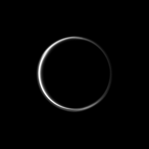 Hazy Ring of Titan  The Cassini spacecraft looks toward the dark side of Saturn's largest moon and captures the halo-like ring produced by sunlight scattering through the periphery of Titan's atmosphere.