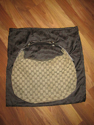 Gucci Purse Bag Handbag Shoulder Monogram Hobo Brown Canvas Leather Authentic Source Ebay.com http://www.ebay.com/sch/i.html?_trksid=p5197.m570.l1313&_nkw=hobo+handbag&_sacat=0 Gucci bag! Brown monogram canvas Hobo With dark brown leather strap and Silver Horsebit hardware pre-owned- in good condition- has a few minor stains and tears throughout- please see pics for details comes with dust bag guaranteed authentic or your money back! Please check my feedback as I only sell authentic designer items contact me for more picures or any questions check out my other auctions! Hapy bidding! Ships from hollywood, fl currently selling for $60