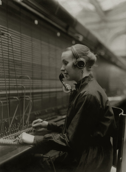 The 'operator'. Woman at a telephone console of an exchange, 1934.