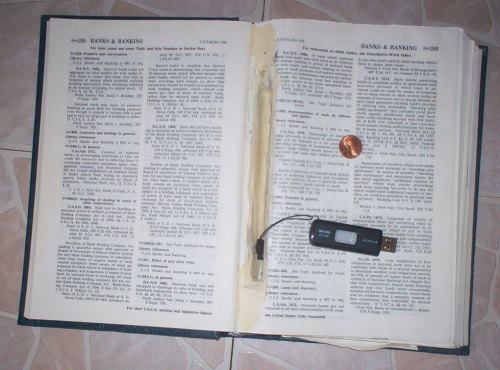 "What Paper Means in Prison Above: A flash drive embedded in a copy of ""Code of Federal Regulations, Title 12, Banks and Banking.""This story produced in partnership with The Awl."