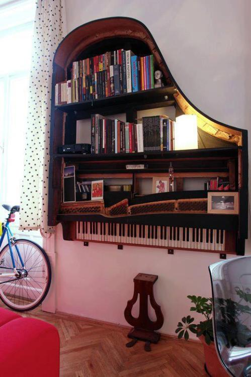 iambecauseiwrite:  bookshelfporn:  Piano Bookshelf.  Become a fan of Bookshelf Porn on Facebook.  Crystal! It's a thing you need!  Oh, that's very pretty!  But you'd have to destroy a piano to make it.  I'm not sure I'm okay with that. xD