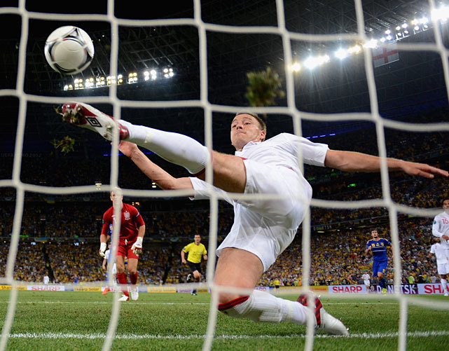 In one of the most controversial plays of Euro 2012, John Terry just clears a shot at the goal line by Marko Devic during England's 1-0 victory over Ukraine on Tuesday. (Laurence Griffiths/Getty Images) TURNER: Fight broils game technology after England's controversial victoryHONIGSTEIN: Three thoughts from England's victory over UkraineGALLERY: Euro 2012 in Photos