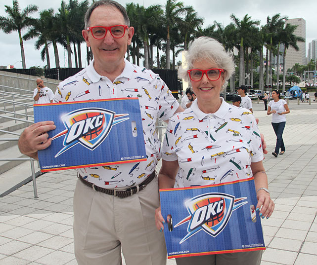 These Thunder fans, who clearly take fashion advice from Russell Westbrook, pose for a photo before Tuesday's game against the Heat in Miami. Unfortunately for these fans, things didn't work out for Oklahoma City. LeBron James scored 26 points to go along with 12 assists and 9 rebounds as the Heat took a 3-1 series lead with a 104-98 victory. Miami will try and close out the series in front of its home crowd on Thursday. (Ray Amati/NBAE via Getty Images) ROSENBERG: LeBron does it all in Heat victoryTHOMSEN: LeBron fights cramps to beat ThunderGALLERY: SI's Best Photos From Game 4GALLERY: Russell Westbrook: Fashion Icon