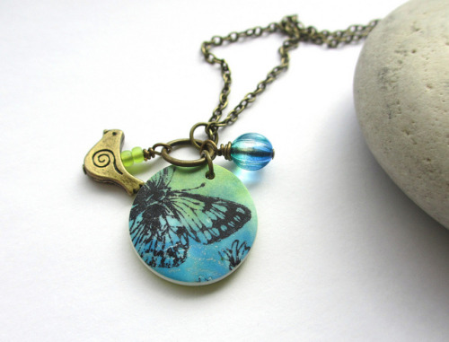 Butterfly and Bird necklace on Flickr.