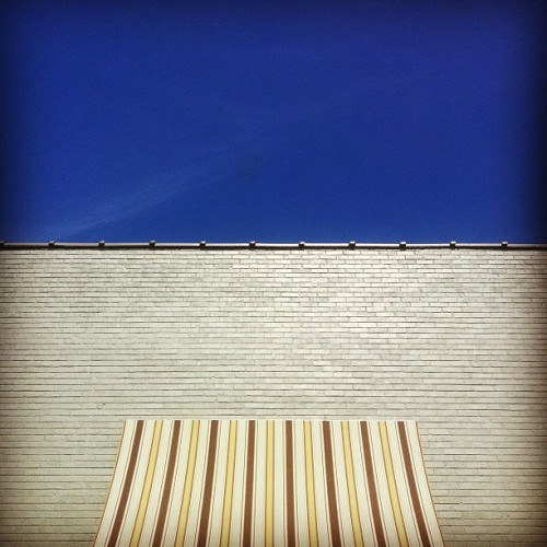 #simple #blue #sky #brick #awning (Taken with Instagram)