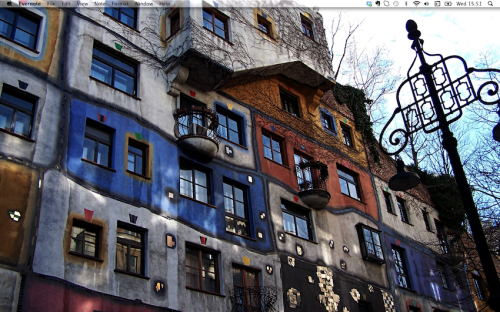 So this is my desktop.I decided to share after seeing an article on the Guardian by Jon McGregor, who has shared a picture of his own desktop.Mine is even more sparse than his! I keep everything in folders in the Finder.Unlike him, I have found tons of uses for Evernote. When I first downloaded it, I had no idea what I needed it for. But now I find it is an nicer, tidier way to organise my documents. I am not a fan of TextEdit so I end up using Evernote instead. Documents are safe as well, as you can log in to your Evernote from another computer, much like Dropbox. Evernote also has the best icon ever, of an elephant's head. My desktop picture is of the Hundertwasser Haus in Vienna. I visited the place last year and it is one of the most playfully and innocently childlike, gorgeous pieces of art and architecture I've ever seen. Jon McGregor: My desktop