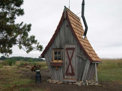 Many of you have liked our posts on tree houses, backyard cabins, and other retreat sorts of buildings constructed from reclaimed wood. Now, there's this: Cottages and garden sheds constructed out of wood salvaged from barns and other buildings. Designed and built by Minnesota-based The Rustic Way. Owner Dan Pauly also builds custom furniture and other items from reclaimed wood. Nice design, isn't it?