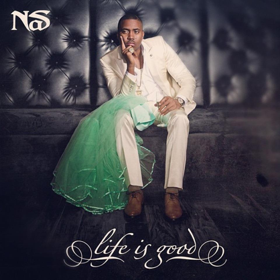 Look Of The Day- This Cover of Nas's New Album Life Is Good, is more then a styilsh gesture, this is ART. This photo is poetry, take a look at a man who owns his truth and pain. Sitting like King should with the ghost of his ex wife's watermelon colored wedding dressed layed accross his lap. Flamboyant but jagged at the same time. I LOVE THIS!