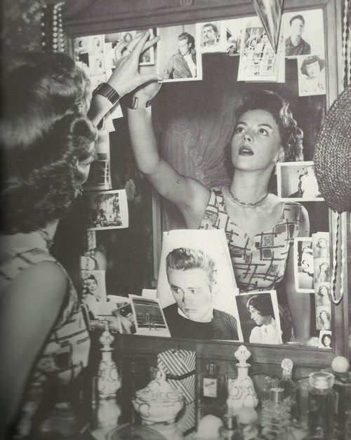 Natalie Wood puts up pictures of James Dean in her dressing room after his death.