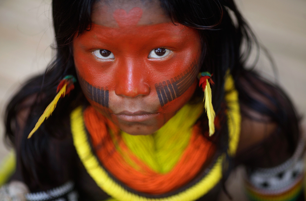 From Rio+20, one of 37 photos. An indigenous child from Kayapo tribe attends first indigenous assembly for the Rio+20 Conference at Kari-Oca village in Rio de Janeiro, on June 14, 2012. Indigenous people from around the world are visiting the village for the Rio+20 United Nations Conference on Sustainable Development. (Reuters/Ricardo Moraes)