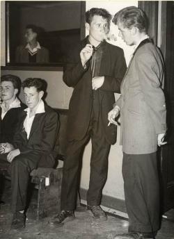 theniftyfifties:  Teddy Boys stag-line at a dancehall, 1955.