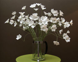 DIY Simple White Paper Flowers via craftstylish.com Remember: they don't have to be JUST white, use patterned or colored paper to zest it up!