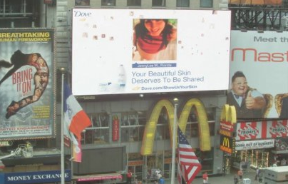 How neat is this!? Rock and I appeared in a Dove ad in Times Square, New York City!    Dove has created an innovative social media campaign! Simply go to their Facebook page, submit your photo and a short tweet and your photo will appear on their huge Times Square billboard once approved. They will also send you a live shot of the picture!    This is definitely a bucket list item checked off for the record! :) Since you are only allowed one person per picture submitted, I decided to go with a pregnant one.       The photo is me at 35 weeks prego, notice my glowing belly! This was shot by Lizzie Easton, she's an amazing Miami-based photographer who has a prolific collection of women, maternity, birthing photos. For more info, check her out at http://www.lizzieeastonphotography.com.