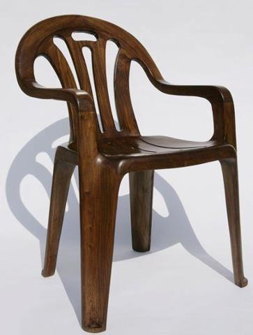 thetiffy:  Plastic chairs… made out of wood. Perfect.