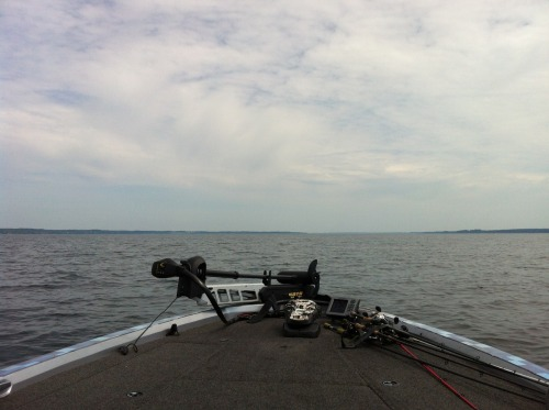 "Some shots from day 2 of practice at lake Cayuga.  We wound up getting stranded for three hours in the middle of the lake (in 90 degree heat with no wind). I had a defective charger that Dwayne Waded me into believing it had completely charged my batteries… and it didn't. We were chomping through some thick eurasion milfoil and I attempted to put the featherwick cruise ship into gear and blew the bushing square off the prop. Good thing the dudes at Bass Pro Shops in Auburn are saints and were able to stay late after the store had closed, and fix my boat. We were having a less than great practice until we got stranded, oddly enough. We were sort of wind drifting across a 10 ft flat in the middle of the lake and started slamming the fish - I was too depressed about my boat to even pick up a rod, but Steve kept ranting the ""fish on's,"" so I was bullied into picking up my 7`6 Cashion Flippin` stick."