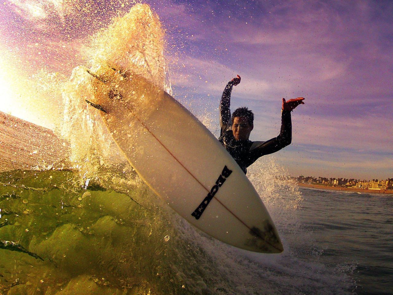 justjobe:   via@GoPro Sunset at the beach with shredder Jarrod Bell. Photo by GoPro superfan Robbie Crawford.Happy International Surf Day! Get out and surf!