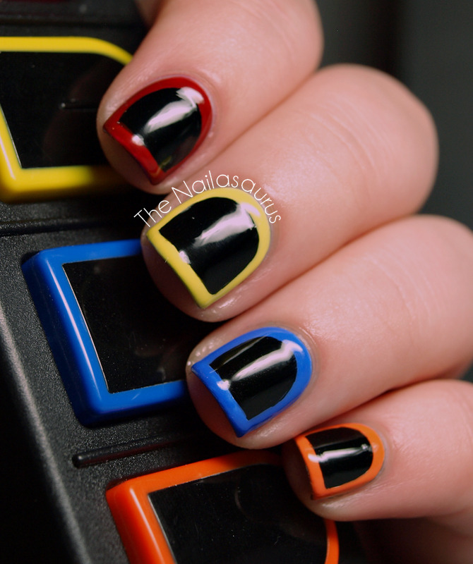 thenailasaurus:  The Nailasaurus: Guitar Hero Nail Art 2.0  Guess I have something new to tryout soon