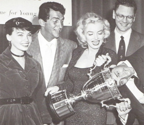 "alwaysmarilynmonroe:  Marilyn receives the Redbook Award in March of 1953 as the ""Best Young Box Office Personality."" Wither her are Leslie Caron, Dean Martin, Redbook editor Wade Nichols, and Jerry Lewis."