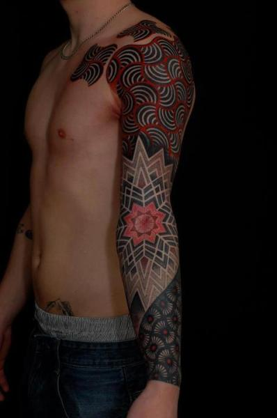 Sick Tat! Dot Work Paradigms Serious tattoo right here. Black lines clash with dot work and make a completely unique piece that could only be described as pretty fucking amazing! the detail is ridiculous and it literally looks like art stamped onto the arm. Photo by Tattoo Art Magazine.