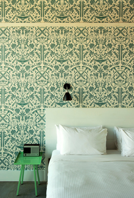 Source: Wythe Hotel Simple pieces (the side table, wall light etc) set against a busy wallpaper is just the way to do it. Adding more pattern to the mix would get confusing and by keeping the colours in the same family with splashes of the black, it gives the room continuity. Love that wallpaper. It was custom made by Dan Funderburgh. Check him out - definitely worth a look!