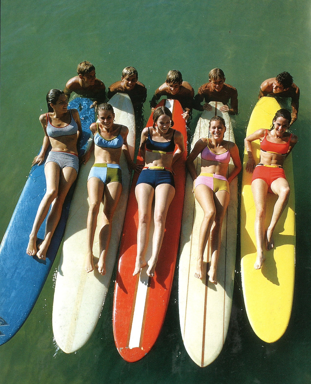 Sunning surfers in 1965, courtesy of Everett Collection.