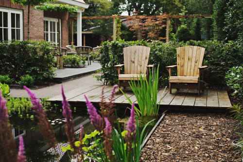Leaf Readers Design Outside!   A design for a 'timeless garden' with a mixed modern green feeling, a couple of seats and a focus on connecting house and garden.  (You can check out the other pictures of this garden by clicking the link.)