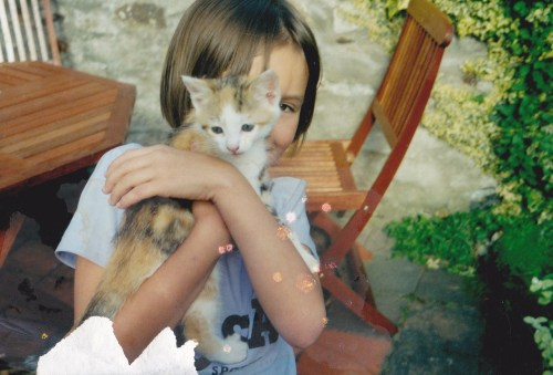 Me and my cat when she was a kitten (: