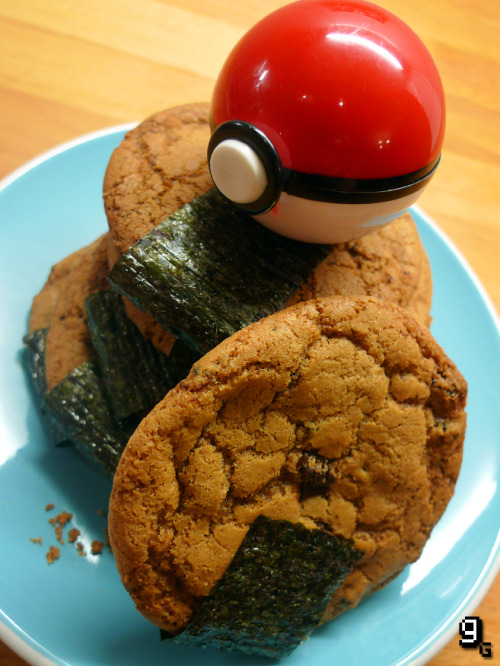 "gourmetgaming:  Request: Pokémon – Lava Cookies  Lavaridge Town's speciality, and now a Gourmet Gaming speciality too! Originally, the Lava Cookie is referred to as a ""rice cracker"" which frankly doesn't sound too exciting, so I turned to the awesome poké visual appeal of this trusty status heal for inspiration. Combining the idea of an Asian ""rice cracker"" and a ""cookie"", I was pleasantly surprised by my rash decision to create the Lava Cookie as an ""East meets West"" fusion of strong, bitter chocolate chips and aromatic, salty nori in a sweet and chewy all-American cookie. Perfectly restoring and unusually delicious, for pokémon and trainer alike. This recipe makes 12 Lava Cookies. What you will need: A large mixing bowl, a wooden spoon, a pair of scissors, a small bowl, and a baking tray. For the Lava Cookies: 85g / ⅓ Cup Butter (Melted) 125g / ⅔ Cup Dark Brown Soft Sugar 50g / ¼ Cup White Granulated Sugar 1 Large Egg (Room Temperature) ½ Teaspoon High Quality Vanilla Extract 125-150g / ¾ - 1 Cup Plain Flour ¼ Teaspoon Baking/Bicarbonate Soda ¼ Teaspoon Salt 75g / ¾ Cup Dark Chocolate (Chips or Chunks) 1 Sheet of Nori (Cut into small pieces) To Garnish: 25g / ¼ Cup Dark Chocolate (Chips or Chunks) 1 Sheet of Nori (Cut into strips) Making the Lava Cookies: Preheat the oven to 170C/340F and have a baking tray ready. Cream the melted butter, soft brown sugar and granulated sugar together until smooth. Add the egg and vanilla and mix until well combined. Sieve in the flour, baking/bicarbonate of soda and salt. Stir gently with a wooden spoon, then add the chocolate chips and nori, and mix gently once again. The dough should come together, and still be very moist/sticky, but able to be handled. If too loose, add more flour a tablespoon at a time. Add more melted butter a teaspoon at a time if it's too solid. Once at the right consistency, take a tablespoon of the dough, roll it in your hands into a ball, then place it on the prepared baking tray. Make sure the cookies have enough room to spread; I only baked 4 at a time. Bake the cookies in the oven for 10-12 minutes, then remove them from the oven and allow them to cool slightly before removing them from the tray, and setting aside to cool completely. Garnishing the Lava Cookies: Once the cookies are cool, melt the chocolate in a clean bowl. Add a small blob of the warm chocolate near the bottom of each cookie, to act as a glue, then attach the strip of nori. Once the chocolate has cooled, and the nori is stuck, turn the cookies over and repeat the process. Tuck the remainder of the nori strip up around the back of the cookie, and neatly press it against the chocolate to help the nori stick. Once the chocolate has set, enjoy your Lava Cookies and feel your status refresh! I really was impressed with how these cookies turned out! They're ultra sweet, but the nori adds a fresh, sharp contrast. Feel free to try these with white or milk chocolate too. In the winter, or if in need of a little extra 'fire', a dash of ginger would be great for a warming touch. Certainly, the Lava Cookie recipe will act as my base from here on in when baking cookies, they're so delicious, I've gotta nom 'em all! Like this? You might also enjoy the Pokémon – Poffins."