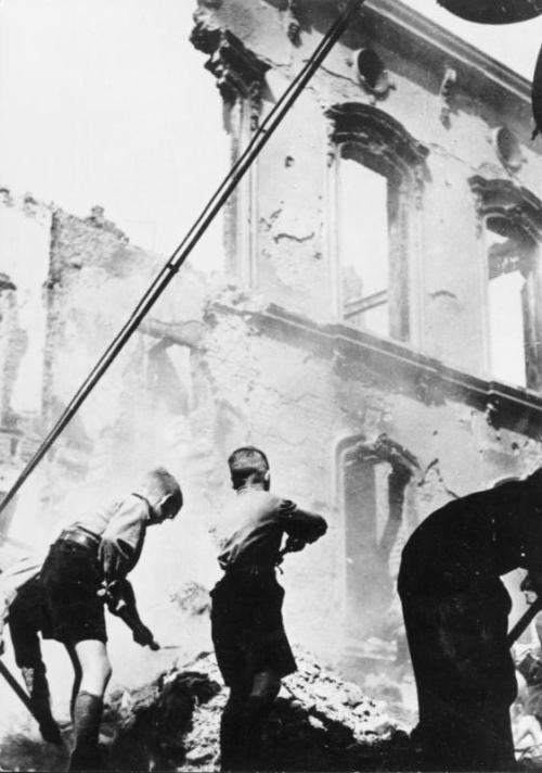 Hitler Youth cleaning up after an air raid in Berlin, 1943.