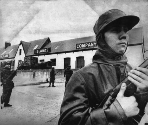 4 April 1982: An Argentine marine stands guard outside the headquarters of the Falkland Islands Company in Port Stanley after the Argentine occupation of the Falkland Islands