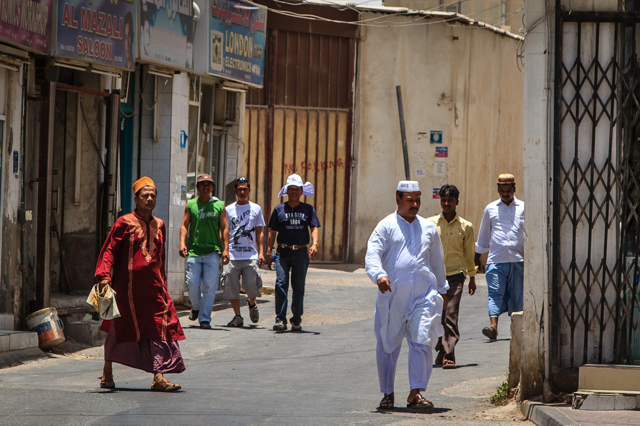 Toward prayer, by Omar Chatriwala. Muslim men on Doha's streets head toward a mosque for Friday prayer.