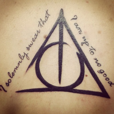 This is my first tattoo. I have grown up loving Harry Potter so i figured why not get a tattoo so i'll always remember what i based my childhood on. This picture was taken right after it was finished. Done by Al at Pain and Pleasure in Sandusky, Ohio