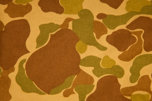 A brief history of camouflage for war.   Led by the opinions of Winston Churchill who believed deception to be a powerful diversionary, and psychological tactic, the British army wholly adopted camo, followed by the United States, Russia, Italy, Germany, and Portugal.   A brief history of camouflage for fashion.   Many of the patterns used by streetwear brands for fashion purposes today are subtly tweaked (or outright copied) variations of the Woodland camo.   Wearing camo in public is for visibility, not deception.