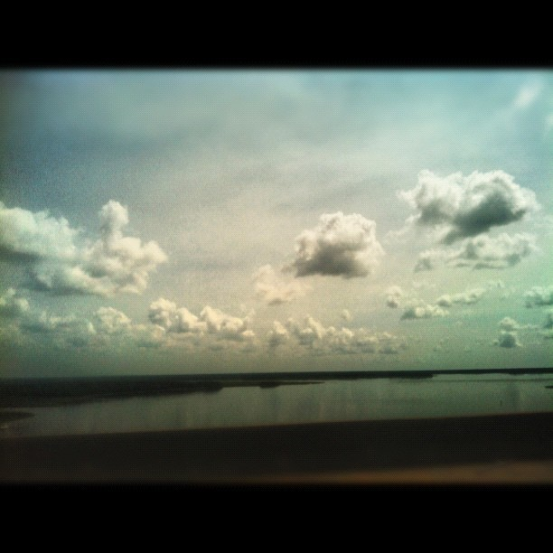 171 -  lowcountry sky #clouds #sky #reflection #water #river #bridge #photoaday # #photooftheday  (Taken with Instagram)