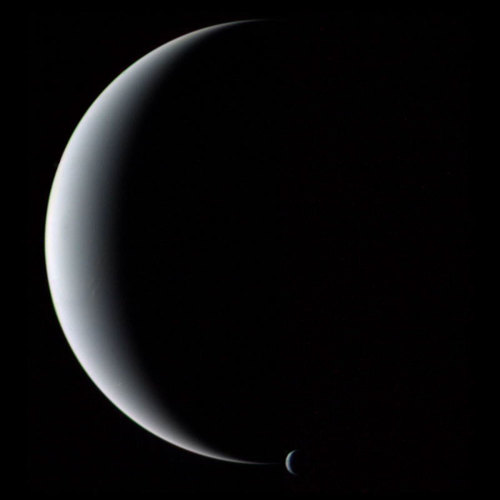 n-a-s-a:  Crescent Neptune and Triton  Credit: Voyager 2, NASA
