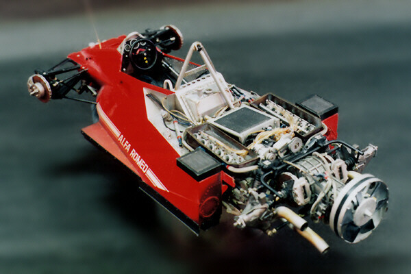 "Brabham BT46B Fan Car | Formula 1 | 1978 The Brabham BT46B was conceived and built to strike back at the dominant Lotus cars in the 1978 Formula 1 season. The Lotus cars introduced the concept of ground effects, in which engineers realized the air passing under the cars was as important as the air running over the car. If the air under the car was able to pass more smoothly underneath, the air would go through more quickly. Thus, the air pressure beneath the car would be lower than the pressure above it, allowing atmospheric pressure to further help to push the car down onto the track. With the increased downforce, the cars were able to corner much harder and faster, giving the cars an advantage. Dissimilar to more conventional front and rear wings the ground effects solution did not create more drag, allowing cars to maintain their high speeds on straights without additional horsepower. Needless to say, this was a very major discovery in the sport. As half of Formula 1 is always a behind the scenes battle between team engineers and the rulemakers, the engineers are always looking for ways to get a couple steps ahead of both the other teams and the FIA. Designer Gordon Murray wanted to do just that for the Brabham team, and the BT46B was born. Murray was one of the first designers after Lotus to realize how important ground effects were but couldn't do it in the same manner as the Lotus engineers. Lotus, using a sleek V8, was able to vastly reshape the bottom of the car around the engine to create a low pressure area under the car. However, due to the size and shape of the Alfa Romeo flat-12 used in the Brabhams, Murray would not be able to achieve the desired results with the same technique. Instead, Murray took a genius jump outside the box. Since natural airflow alone wouldn't work to improve downforce in his cars, Murray installed a giant fan to the rear of the car. The fan was connected to the car's engine by clutches, and the engine bay of the car was sealed to create a low pressure zone under the car. As the fan was connected to to the engine itself, it was said that when drivers got on the throttle the car would visibly squat down on itself as the downforce increased. The two Brabhams debuted in the eighth race of the 1978 season at the Swedish Grand Prix at Anderstorp. The Brabhams qualified second and third, behind Lotus driver Mario Andretti. In the race the Brabhams proved to be a success, however, the car driven by John Watson spun off on the 19th lap, taking him out of contention for a top spot in the race. The Brabham driven by Niki Lauda, however, powered past Andretti in his Lotus and ended up winning the race by over 30 seconds. Rival teams immediately protested and the heads of the other teams went after Brabham owner Bernie Ecclestone, who wanted to become president of the Formula One Constructors Association. To become president of the FOCA, Ecclestone would need their support and he made a deal with the FOCA to race the car a few more times before withdrawing the car from competition. However, the car was deemed illegal before it saw any more track time and Ecclestone, of course, complied without further argument. Ecclestone did go on to become president of the FOCA in 1978, and remains very involved in Formula 1 to this day. The Brabham team returned to their original chassis design and never raced the Fan Cars in Formula 1 again, losing the 1978 season championship to Lotus. One of the brilliant Fan Cars can still be seen in action at the Goodwood Festival of Speed every so often. (Sources: ""The Secret Life of Formula 1,"" Wikipedia, Jalopnik)"