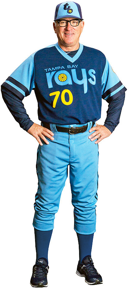 "Rays manager Joe Maddon poses in the team's ""fauxback"" uniform from 1979, 19 years before the Tampa baseball franchise existed.  The Rays will sports this look on June 30 in a game against the Tigers."
