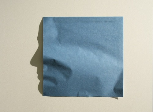 2headedsnake:  junk-culture.com Kumi Yamashita creates amazing shadow art by creasing square sheets of origami paper so that, when they're lit from the side by a single light source they reveal beautiful facial profiles.