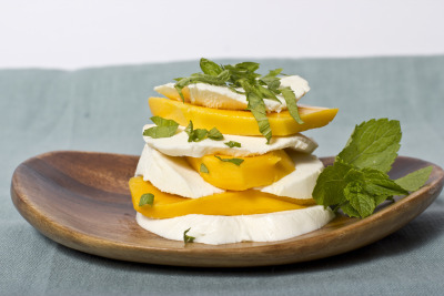 elyseindc:  murrayscheese:  mango, mint, and mozzarella with a little coarse salt. summertime!  Now this looks incredible.   Two things:1. Yum2. There is a Murray's tumblr