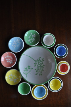 Salad plate with alder cone pattern and fresh colored little bowls.
